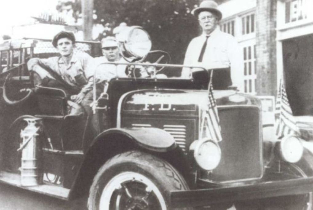 Firefighters in 1928 on a Moreland Fire Truck.