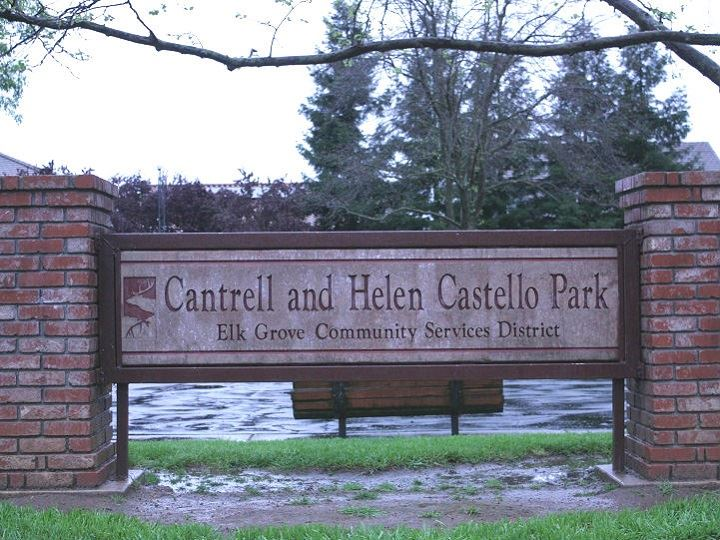 Cantrell and Helen Castello Park sign with brick columns on a rainy day