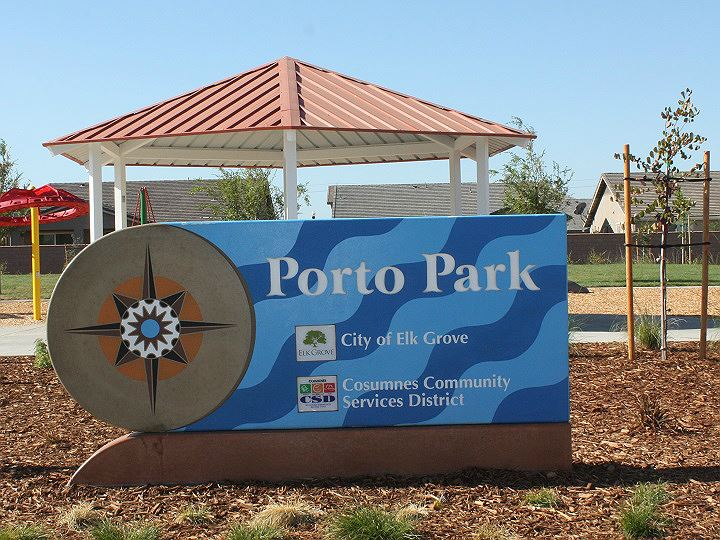 Park Sign with a compass design on the left, and blue wave background