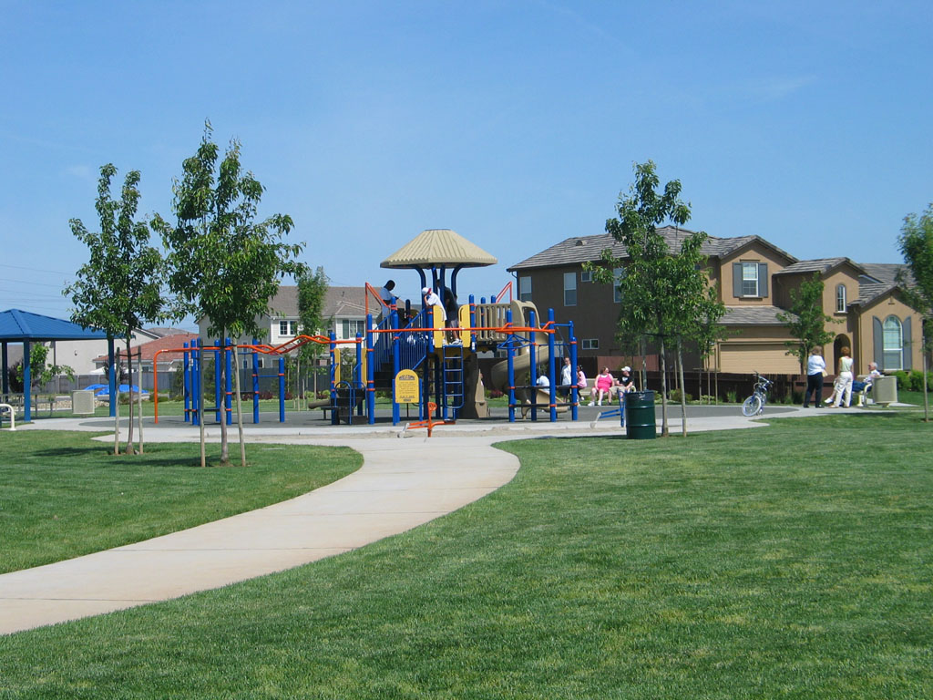 Playground with walkway and grass